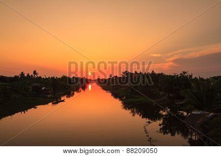 Sunset over Klong Mahasawat canal in Maha Sawat district, Phutthamonthon district, Thailand