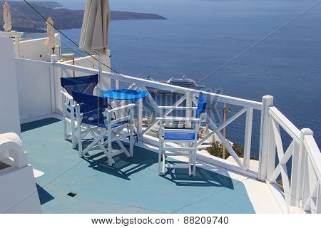 Table And Chairs Against The Sea In Santorini