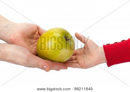 Mother Passes An Apple To Her Child Isolated On White