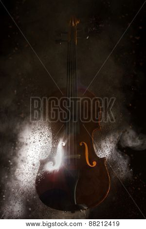 Smoke coming out of an exploding violin - selective focus