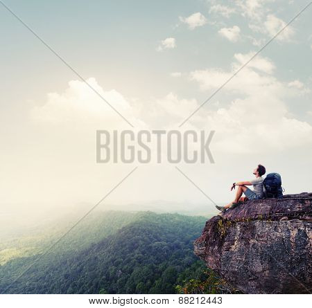 Hiker relaxing on the rock