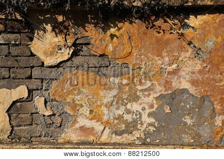 Old brick wall with cracked plaster. Background texture.