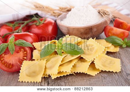 fresh raw ravioli and ingredients