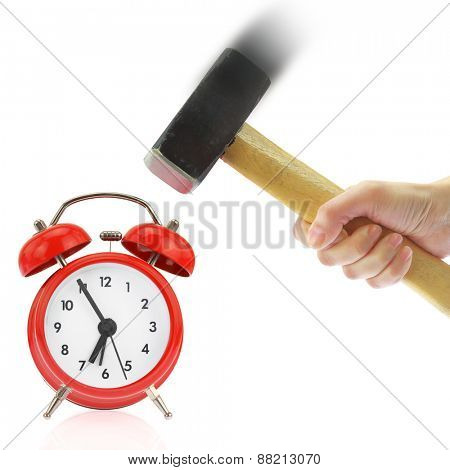 Hand holding hammer and red alarm clock,isolated on white