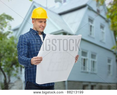repair, construction, building, people and maintenance concept - smiling male builder or manual worker in helmet with blueprint over living house background