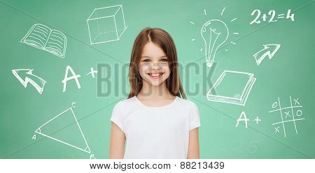 advertising, school, education, childhood and people - smiling little girl in white blank t-shirt over green board with doodles background