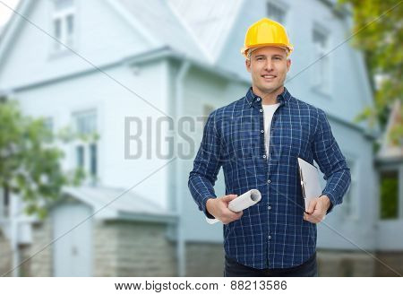 repair, construction, building, people and maintenance concept - smiling male builder or manual worker in helmet with blueprint and clipboard over living house background