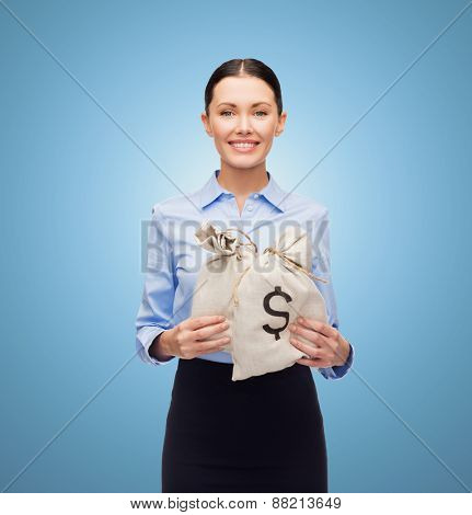 business, people, finances, investments and banking concept - young businesswoman holding money bags with euro over blue background