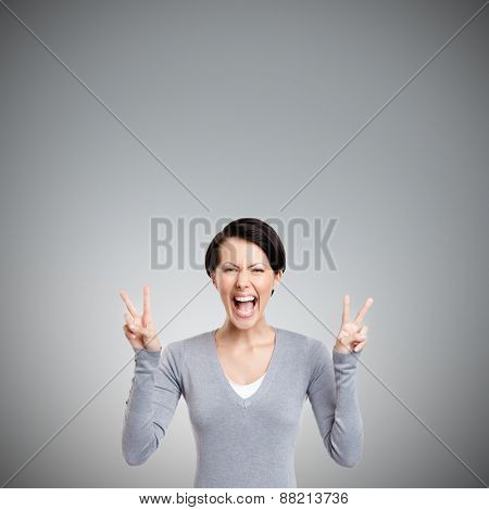 Smiley woman shows peace sign with two hands, isolated on white
