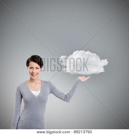 Pointing gesture to the cloud, isolated on grey background