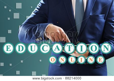 Education concept. Male hand touching screen tablet close-up