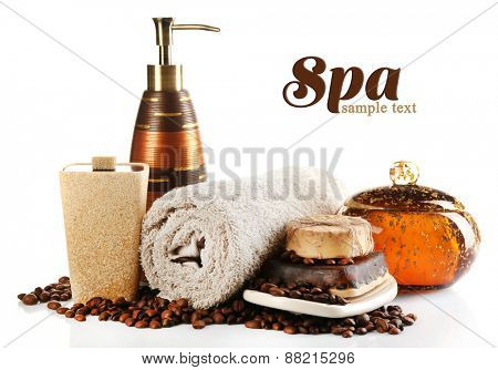 Composition of cosmetic bottle, soap and towel, isolated on white