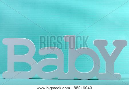 Word baby on blue background