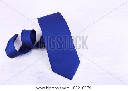 Male necktie on wooden table background