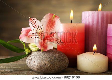 Candles with alstroemeria close up