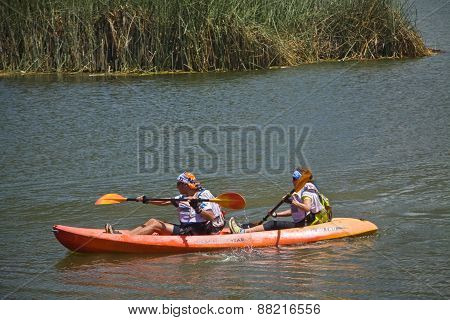 Unidentified tourists kayaking in Yahuarcocha lake, Imbabura
