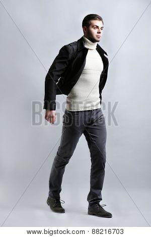 Elegant man on gray background