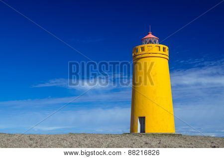 Yellow lighthouse and clear blue sky
