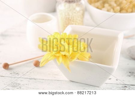 Bowl of spa aroma water on wooden table, closeup