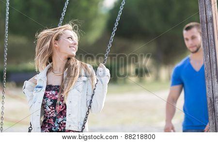 Man Swinging His Girl