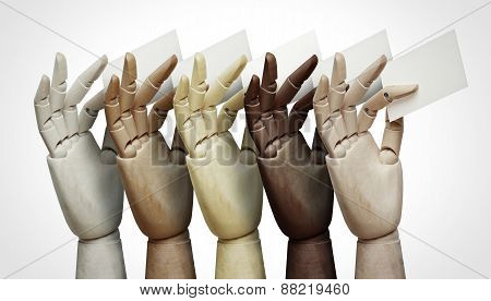 Wood Hands Of Different Colors Holding Business Cards