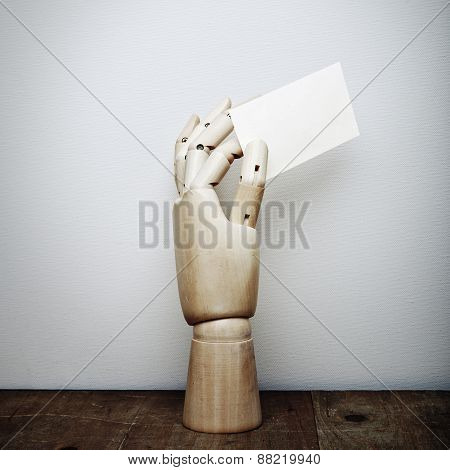 Wood Hand With Blank Business Card