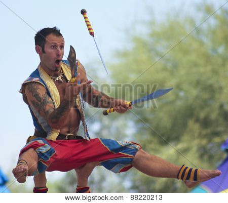 A Performer Juggles Knives At The Arizona Renaissance Festival