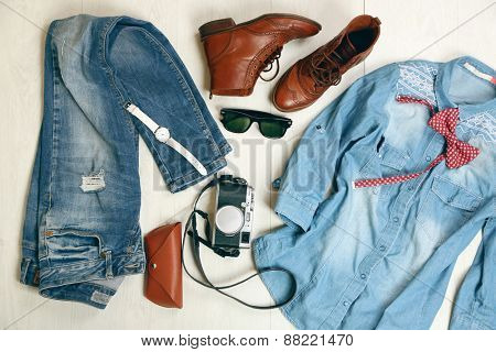 Still life of casual woman. Woman clothes and accessories on wooden background