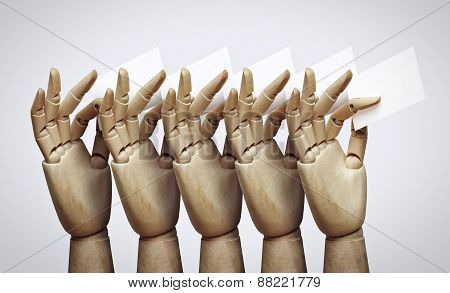 Wood Hands Holding Business Cards