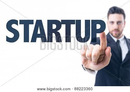 Business man pointing the text: Startup