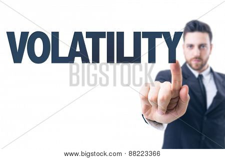 Business man pointing the text: Volatility