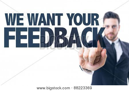 Business man pointing the text: We Want Your Feedback