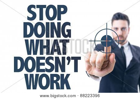 Business man pointing the text: Stop Doing What Doesn't Work
