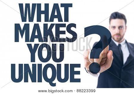 Business man pointing the text: What Makes You Unique?