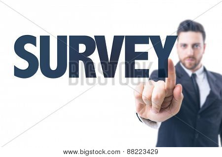 Business man pointing the text: Survey