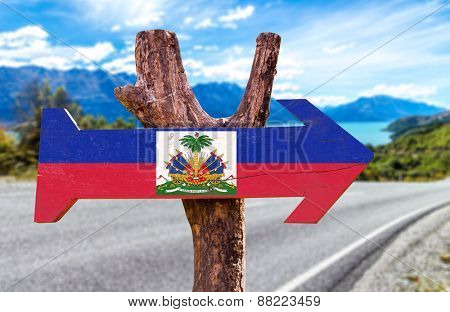 Haiti Flag wooden sign with road background