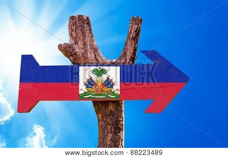 Haiti Flag wooden sign with sky background