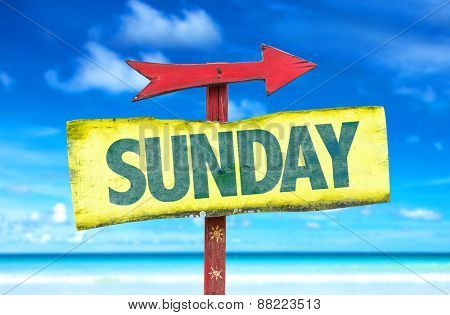 Sunday sign with beach background