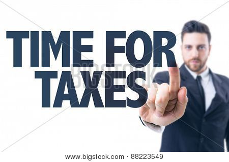 Business man pointing the text: Time for Taxes