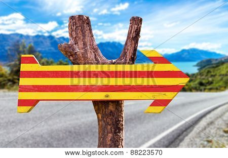 Catalonia Flag wooden sign with road background