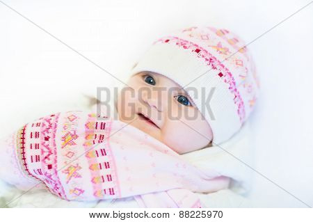 Little Baby Girl In A Pink Hat And Scarf
