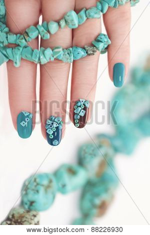 Manicure with beads and turquoise.