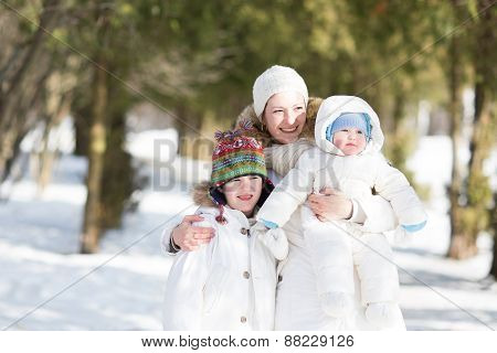Beautiful Young Family In A Snowy Park