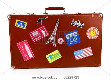 Suitcase with stickers isolated on white