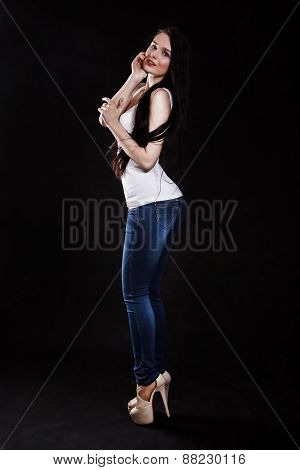 Beautiful Young Woman In A White Shirt And Blue Jeans