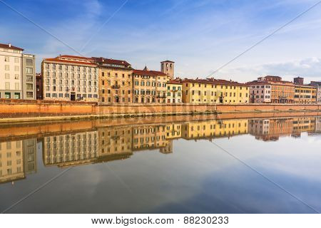 Old town of Pisa with reflection in Arno river, Italy