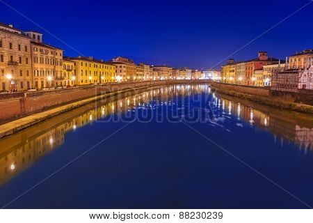 City center of Pisa with reflection in Arno river, Italy