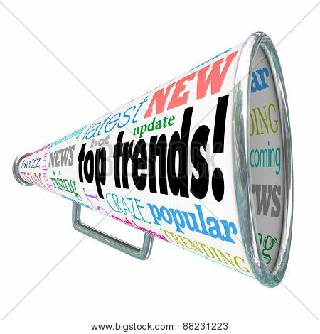 Top Trends words on a bullhorn or megaphone, with rising, news, buzz, latest, hot update, popular, craze, fad and related words