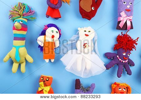 Handmade toys on color table, top view