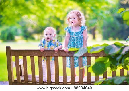Two Kids On A Park Bench